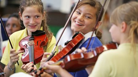 Young violinists at the 'Take a Bow' rehearsals