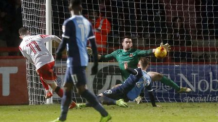 Leyton Orient goalkeeper Sam Sargeant can't prevent Stevenage's Tom Pett from scoring the home sides
