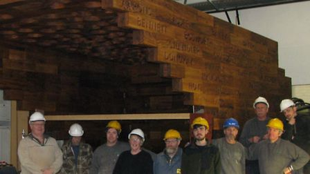 Workers and the Stairway to Heaven memorial centrepice ready to be installed