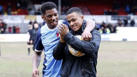Leyton Orient's hat-trick hero Josh Koroma (right) applauds the travelling O's fans with Tristan Abr