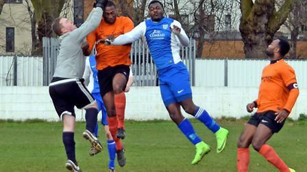 Barking's Omari Delgado challenges the Tower Hamlets keeper in the air (pic Terry Gilbert)