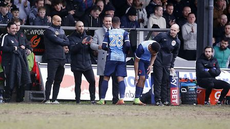Josh Koroma hugs Leyton Orient boss Danny Webb after being replaced at Newport County with the home