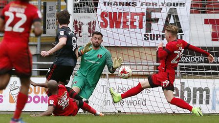 Doncaster Rovers forward John Marquis fires past Leyton Orient goalkeeper Alex Cisak to put his side