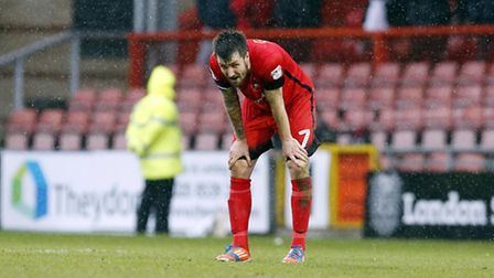 Leyton Orient midfielder Michael Collins looks dejected at the full time whistle (pic: Simon O'Conno