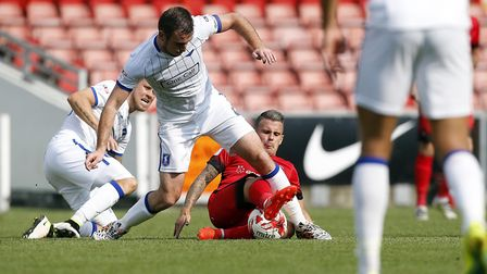 Dean Cox makes a tackle for Leyton Orient against Mansfield Town, which turned out to be his last ap