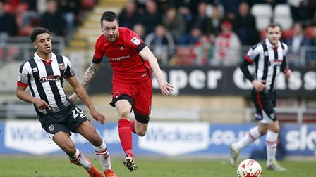Leyton Orient midfielder Michael Collins looks to win the ball back against Grimsby Town (pic: Simon