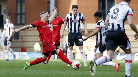 Leyton Orient defender Myles Judd looks to win the ball back against Grimsby Town (pic: Simon O'Conn