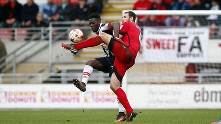 Leyton Orient defender Tom Parkes battles for the ball with a Grimsby Town opponent (pic: Simon O'Co