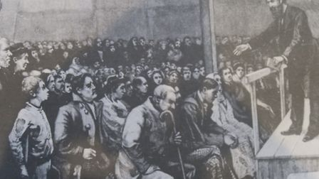 1860s... William Booth preaching in London's East End