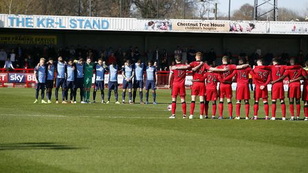 Leyton Orient and Crawley Town players observe a minutes silence at Broadfield Stadium (pic: Simon O