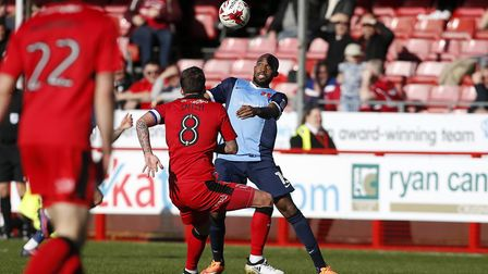 Leyton Orient midfielder Nigel Atangana looks to keep the ball from Crawley Town captain Jimmy Smith