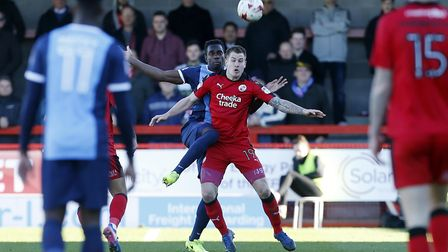 Leyton Orient defender Teddy Mezague tries to win the ball against Crawley Town forward James Collin