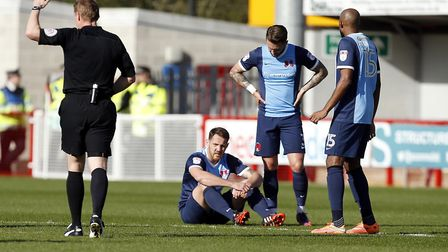 Leyton Orient defender Tom Parkes goes down at Crawley and can't continue due to illness (pic: Simon