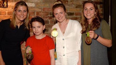 Georgie Twigg, Hollie Webb and Shona McCallin pose with a young fan (pic Graham Hodges)
