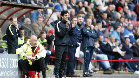 Leyton Orient coach Frederico Morais urges his team on from the touchline after Omer Riza is sent to