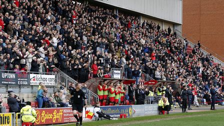 Leyton Orient fans, players and staff members take part in a minute's applause for O's supporter Fra