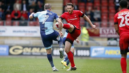 Leyton Orient defender Tom Parkes tries to win the ball from Wycombe Wanderers Garry Thompson, but i
