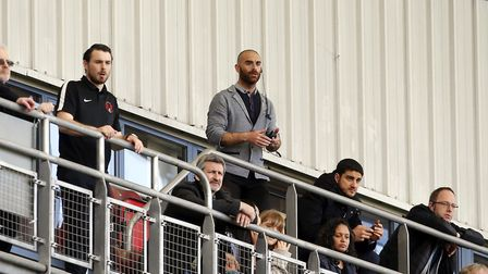 Leyton Orient manager Omer Riza issues instructions from the Gallery after being sent to the stands