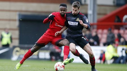 Leyton Orient's Gavin Massey battles for the ball with a Doncaster Rovers opponent (pic: Simon O'Con