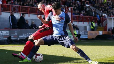 Leyton Orient youngster Steven Alzate tries to keep the ball from Crawley Town's Rhys Murphy (pic: S
