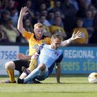 Leyton Orient midfielder Liam Kelly is fouled by Cambridge United's Liam O'Neil (pic: Simon O'Connor