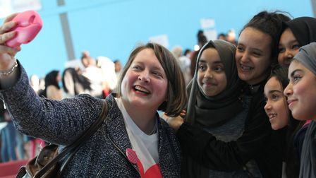 Cllr Rachael Saunders gets to grip with a 'selfie' with young girls during Women's History Month