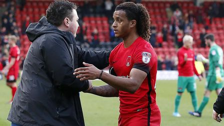 Leyton Orient winger Sandro Semedo is embraced at the full-time whistle after the 2-0 defeat at home