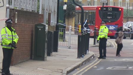 Bow Common Lane cordoned off by police after double stabbing. Picture: MIKE BROOKE