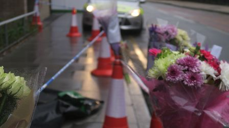 Flowers for Keith Sinclair, 60. at spot in Bow Common where he was stabbed. Picture: MIKE BROOKE