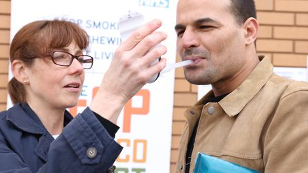 Monitoring breathing outside East London Mosque in Ramadan 'no smoking' campaign. Picture: KOIS MIAH