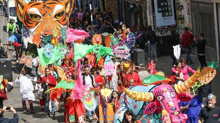 The colourful parade weaves its way to the main site. Picture: KOIS MIAH