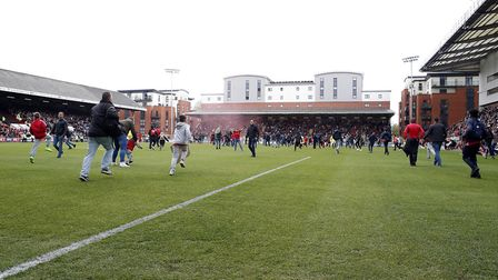 Leyton Orient fans invade the Brisbane Road pitch during Saturday's game with Colchester United and