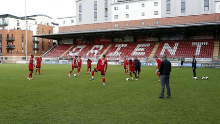 Leyton Orient players warm-up for the final five minutes plus stoppage time against Colchester Unite