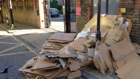 CCTV showing cardboard dumped on pavement in Myrdle Street near a school. Picture: LBTH