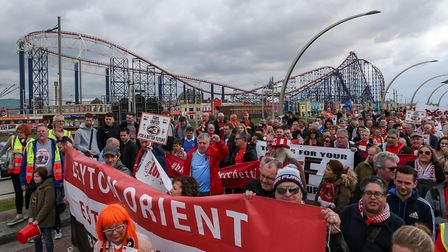 Blackpool fans and Leyton Orient supporters take part in a protest against their owners on Blackpool