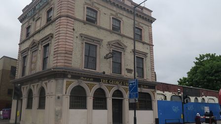 The George, even older than Commercial Road itself, seen next to blue hoarding where Swan Housing wa