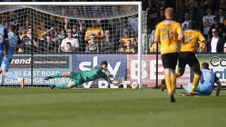 Leyton Orient goalkeeper Sam Sargeant gets down well to save a Cambridge United shot (pic: Simon O'C