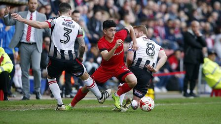 Leyton Orient's Steven Alzate beats two Grimsby Town opponents (pic: Simon O'Connor).