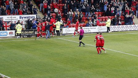 Leyton Orient players congratulate Sandro Semedo after his wonderstrike against Colchester United