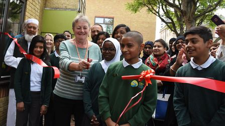 New school library opens at Bigland Green Primary when vice chair of governors Barbara Patilla cuts