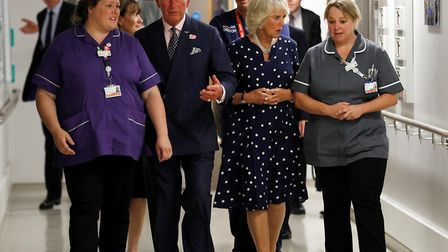 The Prince of Wales and the Duchess of Cornwall (second right) visit members of the public at the Ro