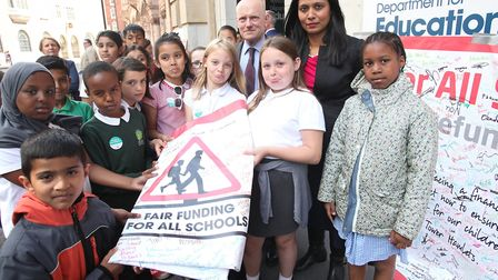 Banner waving with MP Rushanara Ali and Mayor John Biggs outside the Department of Education. Pictur