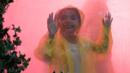 A little girl experiences thrill of walking through edible cloud in the Future Forest exhibition. Pi