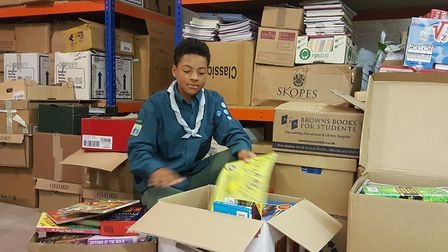 Scouting for books... The 2nd East London Group collecting books at Poplar's Trussler Hall to be sen