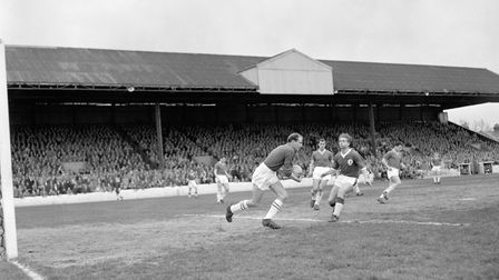 Liverpool's centre forward Dave Hickson rushes in as Leyton Orient goalkeeper David Groombridge clea