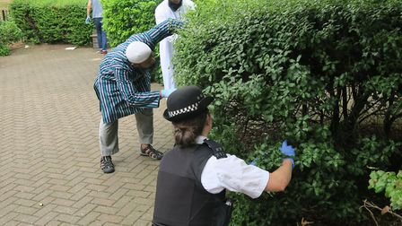 Globe Town mosque leaders helping seacrh housing estate and finding discarded 'laughing gas' caniste
