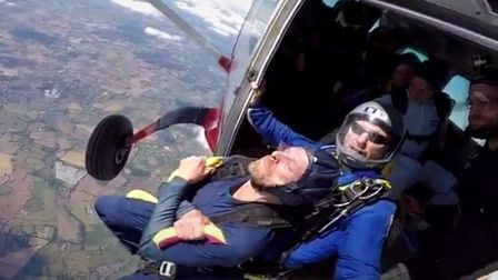 Leap of faith... Alan Booth at 12,000ft about to hurtle towards Earth with his instructor. Picture: