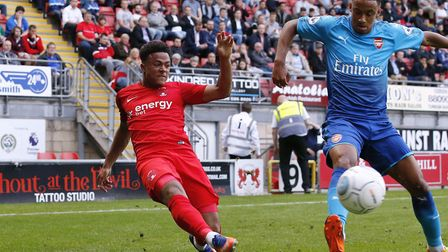 Josh Koroma beats his Arsenal under-23 opponent and looks to pick out a Leyton Orient team-mate insi