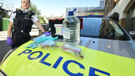 A police officer with the new acid attack response kit issued to response cars in Tower Hamlets last