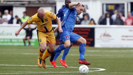 Leyton Orient first-team captain Charlie Lee battles for the ball with Sutton United's Kenny Davis (